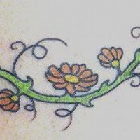 Vine tree tattoo with colored flowers