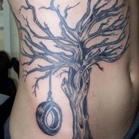 Tree memorial tattoo on belly and side