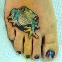 Cute green frog tattoo on foot