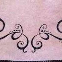 Cute tribal tattoo on lower back