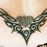 Pretty nice lower back tribal tattoo