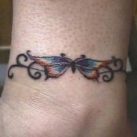 Tribal bracelet tattoo with butterfly and curls