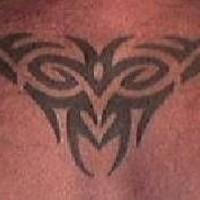 Upper back tattoo of tribal sign