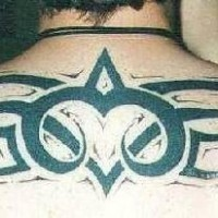Big tribal tattoo on upper back