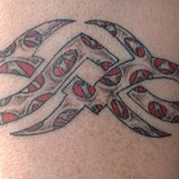 Small tribal sign tattoo with red decoration