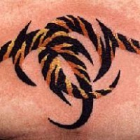 Small tribal tattoo in tiger fur color