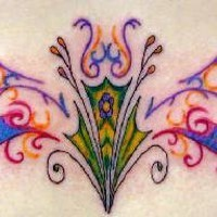 Colorful tribal tattoo on lower back