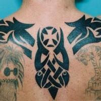 Black ink tribal upper back tattoo