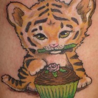 Cute tiger cub with cupcake  tattoo