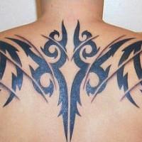 Black tribal upper back tattoo