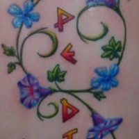 Trumpet vine tattoo with blue flowers and inscription