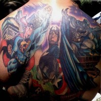 Batman flying on upper back with heroes tattoo