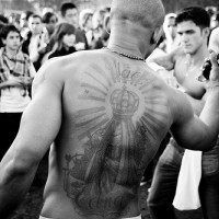 Large tattoo on upper back image of named queen