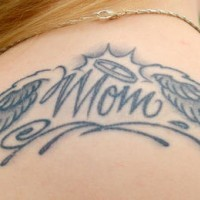Tattoo for mom on upper back winged word
