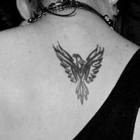 Eagle tattoo little black sign on upper back