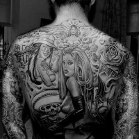 On upper back world of beauties tattoo