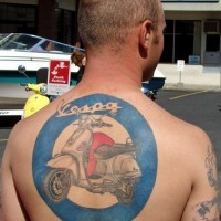 Motorcycle on upper back tattoo in blue circle