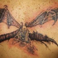 On upper back evil flying devil-bat tattoo
