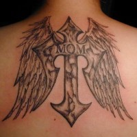 Black designed cross tattoo  on upper back with wings