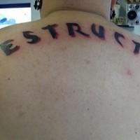 Indestructible on upper back black inscription tattoo