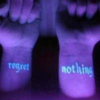 Regret nothing uv ink tattoo