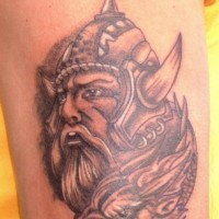 Viking warrior head tattoo with dragon head