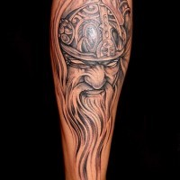 Viking head in helmet with long beard tattoo