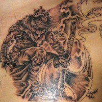 Strong viking warrior with big axe on tattoo
