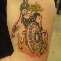 Blond viking warrior standing in fire on tattoo
