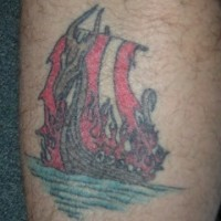 Colored ink viking tattoo of ship in the fire