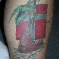 Viking tattoo of colorful ship with green dragon