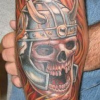 Viking tattoo of skull in helmet with the fire