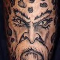 Viking warrior face with angry eyes tattoo