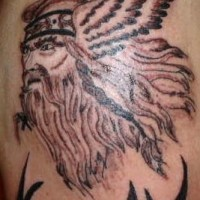 Viking with long hair in winged helmet tattoo