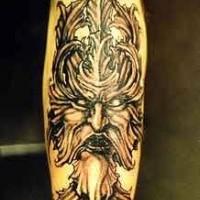 Viking tattoo of dark black warrior head