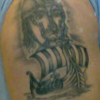 Viking tattoo of big warrior head and the ship