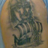 Viking tattoo of big warrior head and the ship
