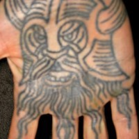 Angry viking warrior head tattoo on palm