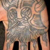 Angry viking warrior head tattoo on palm