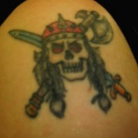 Viking skull tattoo with axe and sword