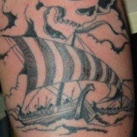 Viking tattoo of the ship and skull in the sky