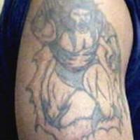 Angry viking warrior torn skin tattoo