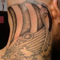 Black ink tattoo with viking ship in the sea