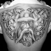 Back tattoo of viking warrior with good eyes and decoration