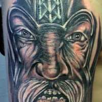Realistic black viking portrait tattoo
