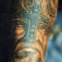 Viking in helmet with the beard portrait tattoo