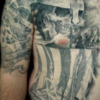 Big tattoo with viking warrior skull and ship
