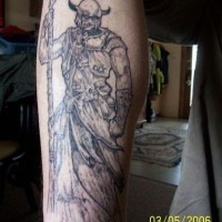 Black tattoo of viking in full length