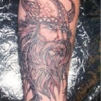Viking tattoo art of warrior head in horned helmet