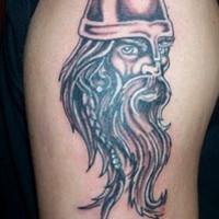 Small tattoo of viking warrior head